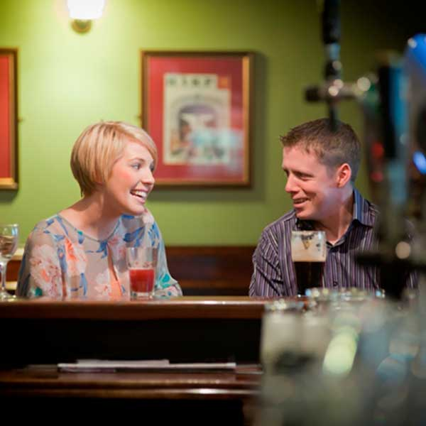 Couple at the bar at The Charlemont Arms Hotel